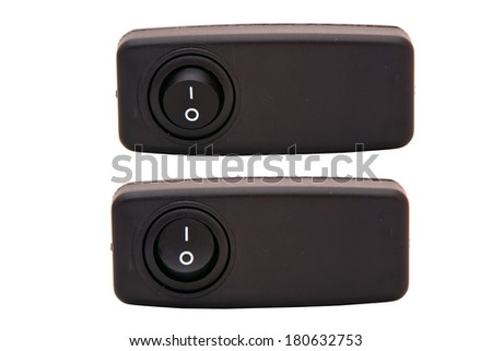 Black toggle switch on white surface
