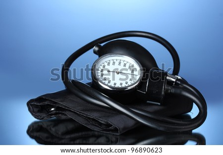 Black tonometer on blue background