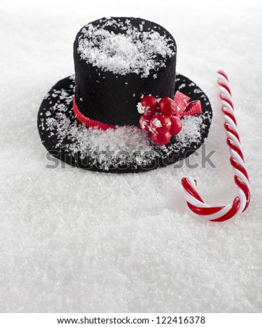 black top hat snowman with Cane on white snow background - stock photo