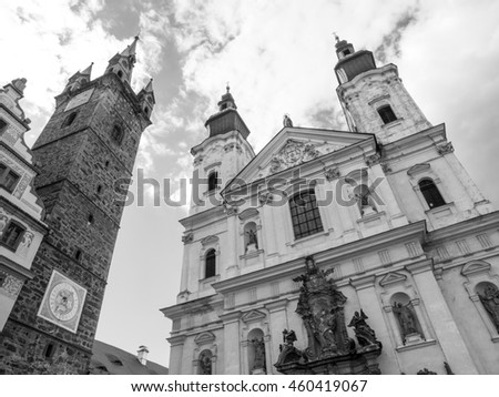 Black Tower and The Church of Virgin Mary's Immaculate Conception and St. Ignatus in Klatovy, Czech Republic . Black and white image.