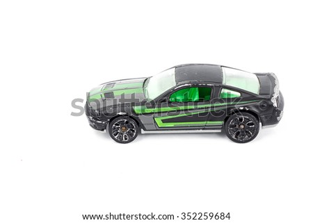 Black toy car isolated on white background.