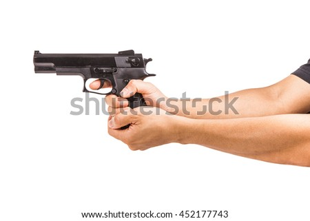 Black toy pistol in a hand on white background