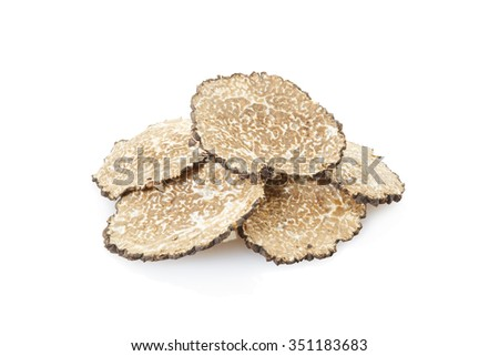 Black truffle slices heap isolated on white, clipping path included