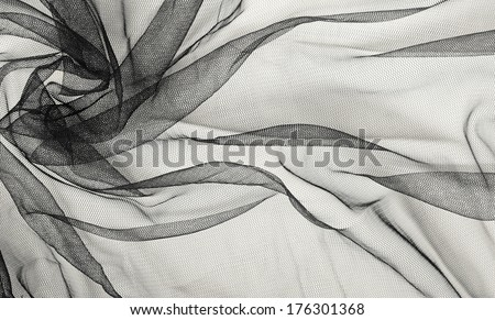 Black tulle background with drapery - stock photo