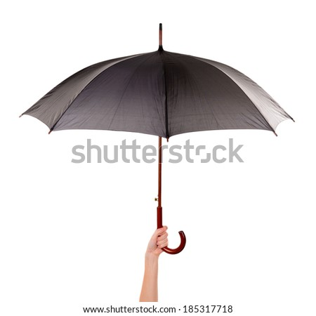Black Umbrella in hand isolated on white - stock photo
