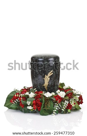 Black urn and floral wreath on white background - stock photo