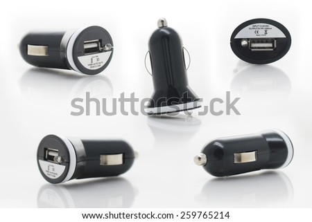 Black USB electronics device car charger isolated on white - stock photo