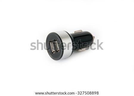 Black USB electronics device car charger isolated on white - stock photo
