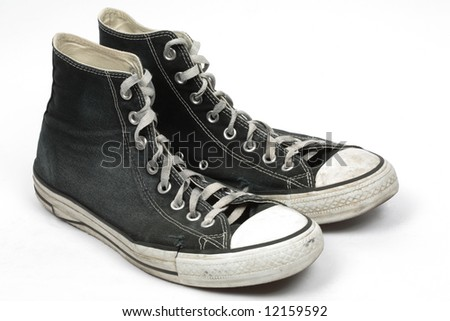 Black used canvas sneakers, isolated