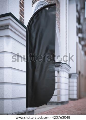 Black vertical wind banner on the street. 3d rendering - stock photo