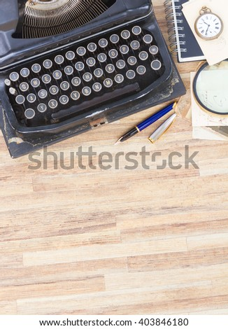 black vintage antique typewriter on working table with copy space, top view - stock photo