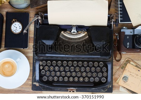 black vintage typewriter with on wooden table, top view - stock photo