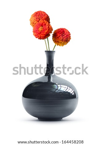 Black vintage vase with a bunch of flowers isolated on white background. High resolution