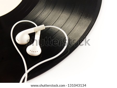 Black vintage vinyl record with  white modern  headphones isolated on white. Love music - stock photo