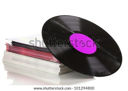 Black vinyl record and stack of magazines isolated on white - stock photo