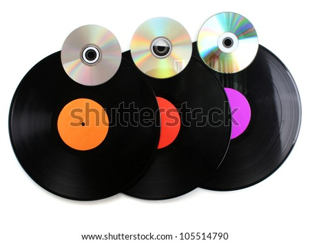 Black vinyl records and CD disks isolated on white - stock photo