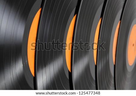 Black vinyl records background - stock photo