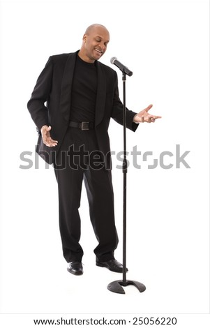 Black vocalist singing into microphone on white - stock photo