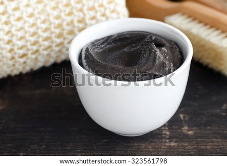 Black volcanic cosmetic clay in a bowl - stock photo