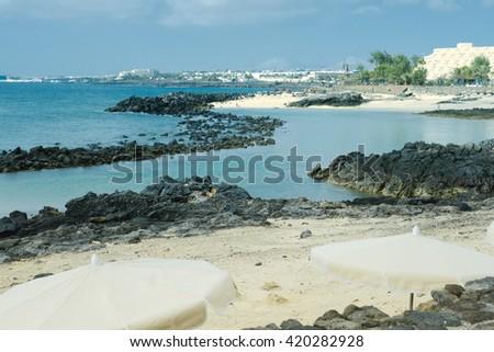 Black Volcanic Rock along the Coastline of  Lanzarote, Arrecife,Canary Islands - stock photo