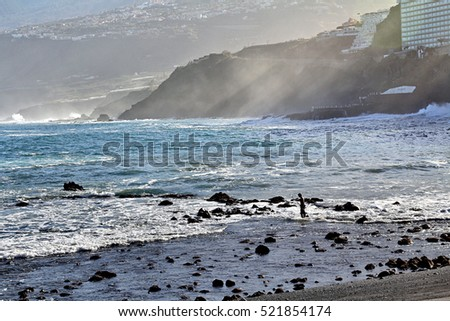 Black volcanic sand on the coast of the island of Tenerife, Spain