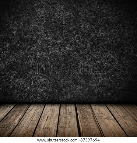 Black wall and wooden floor interior background - stock photo