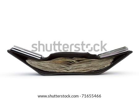 black wallet full on money - stock photo