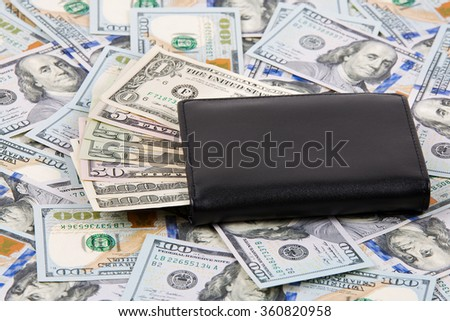 Black wallet with American dollars  - stock photo