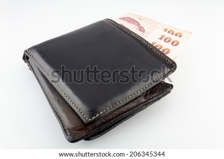 Black wallet with money isolated  on white background.
