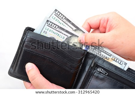 Black wallet with US dollars in the hands on a white background