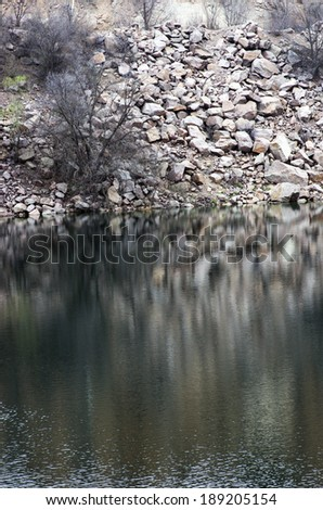 Black water of lake in old quarry  - stock photo