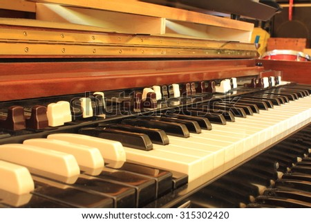 Black, white and brown keys of old organ - stock photo