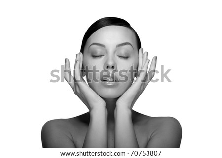 black white Close up a young beautiful brunette girl with hands near her closed eyes isolated - stock photo