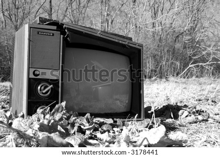 black & white conceptual photograph of abandoned televisions - stock photo
