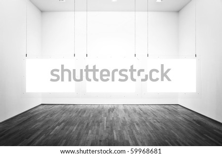 Black & white exhibition room with three pictures and white background - stock photo