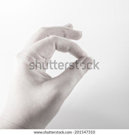 black white gray ok or conducting hand - stock photo