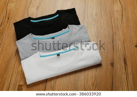 Black white gray T-shirt Folded - stock photo