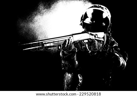 Black white image of spec ops soldier on black background with shotgun - stock photo