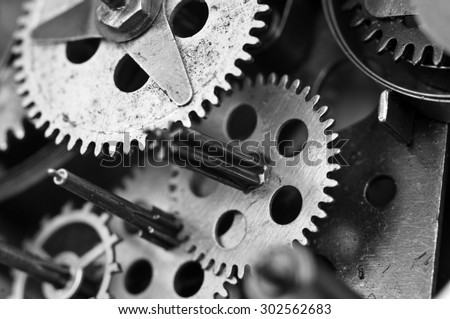 Black white Metal Cogwheels Inside Old Clockwork to success concept for your technology design. Macro