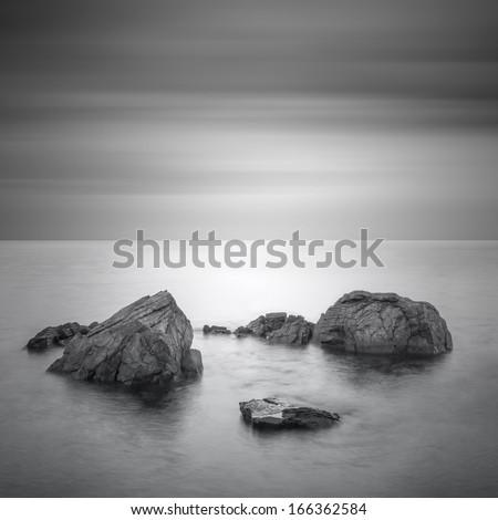 Black & White minimalist seascape with rocks. Black sea. - stock photo