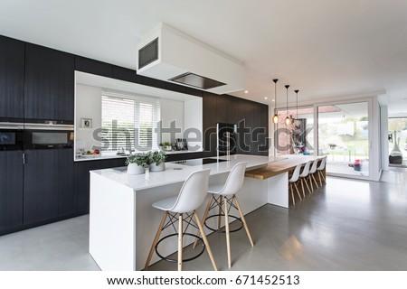 Black U0026 White Minimalistic Kitchen With Wood Details. Concrete Floor,  Composite White Worktops.
