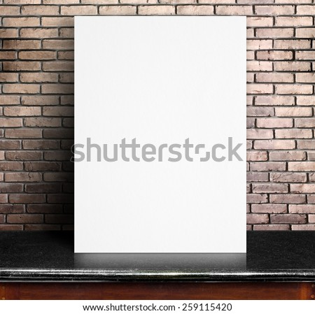Black White paper poster lean at red brick wall and marble table,Template mock up for adding your text - stock photo