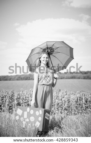 Black white photography of beautiful amazed young lady, field background outdoors