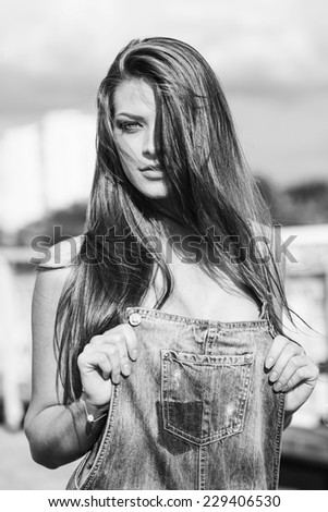 Black white  portrait of a beautiful young woman on a city street. Outdoors, lifestyle - stock photo