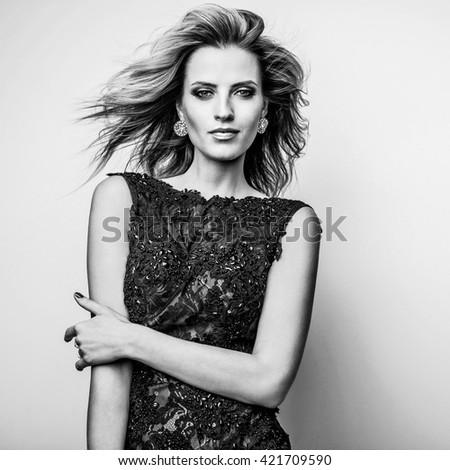 Black-white portrait of beautiful fashionable woman. - stock photo
