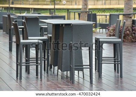 black wicker chairs  outside the restaurant
