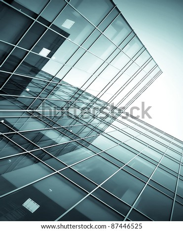 black windows of glass high rise building skyscrapers at night - stock photo