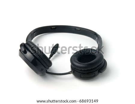 Black wireless headphones isolated on a white background - stock photo