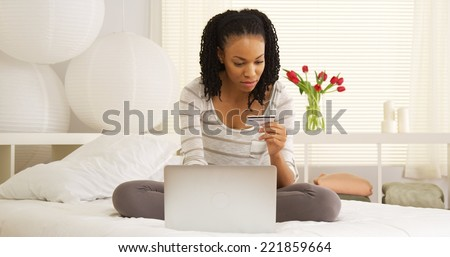 Black woman buying online - stock photo