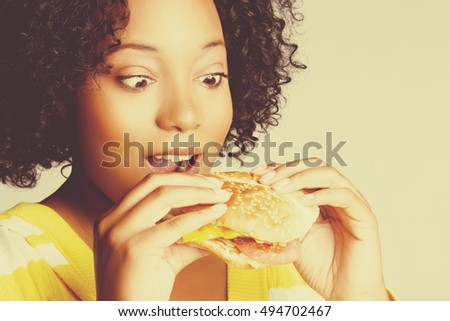 Black woman eating burger sandwich food